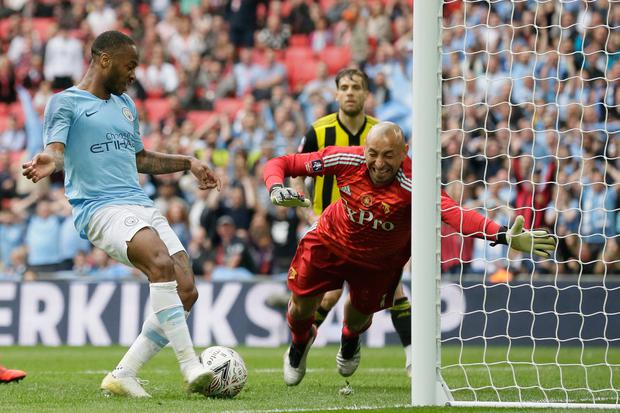 Manchester City's Raheem Sterling (left) scores his side's sixth goal past Watford's goalkeeper Heurelho Gomes. Photo: AP Photo/Tim Ireland