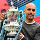 Manchester City manager Pep Guardiola with the FA Cup after Saturday's final. Photo: Glyn Kirk. Photo: GLYN KIRK/AFP/Getty Images