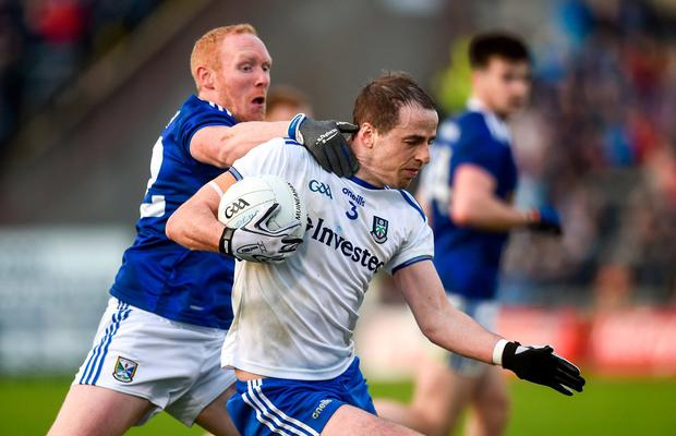 Conor Boyle of Monaghan in action against Cian Mackey of Cavan. Photo: Oliver McVeigh/Sportsfile