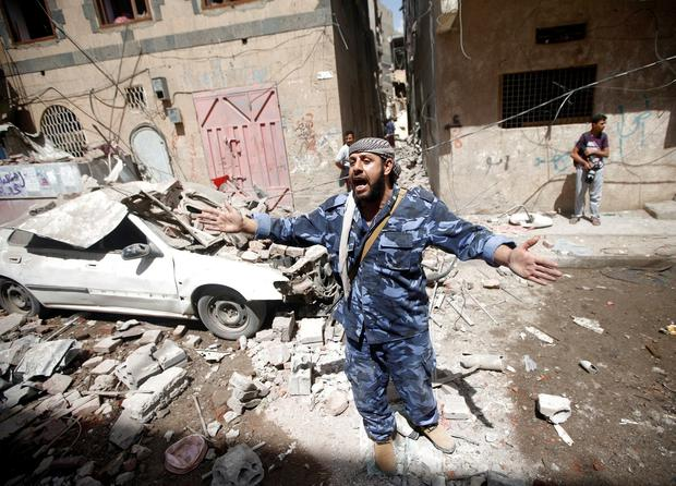 A Houthi security officer reacts at the site of an air strike launched by the Saudi-led coalition in Sanaa, Yemen. Photo: Mohamed al-Sayaghi/Reuters