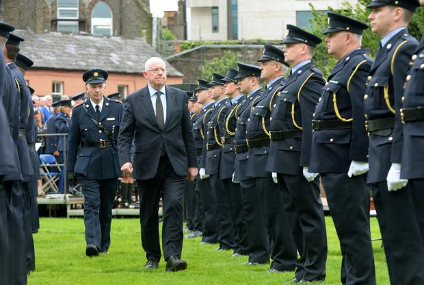 THIN BLUE LINE: Justice Minister Charlie Flanagan inspects the guard of honour at the annual commemoration in Dublin Castle to honour members of An Garda Siochana killed in the line of duty. Photo: Caroline Quinn