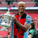 Manchester City's Vincent Kompany celebrates with the trophy after winning the FA Cup last May