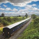 The beautiful midnight-blue Belmond Grand Hibernian is the longest train in Ireland and each of its carriages is named after a different county