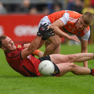 Paul Hughes of Armagh in action against Darren O'Hagan of Down during the GAA Football Senior Championship quarter-final match between Down and Armagh at Pairc Esler in Newry. Photo by Philip Fitzpatrick/Sportsfile