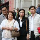 Tess and Danny Valdez, the parents of murdered Jastine Valdez pictured with family at the one year anniversary at Blessed Sacrement Chapel Bachelors Walk Dublin this afternoon Pic Stephen Collins/Collins Photos