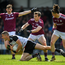 Under-pressure: Adrian McIntyre of Sligo does his best to keep hold of possession despite the attention of Galway's Liam Silke and Kieran Molloy. Photo: Sportsfile