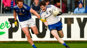 Stephen O'Hanlon of Monaghan in action against Jason McLoughlin of Cavan. Photo: Sportsfile