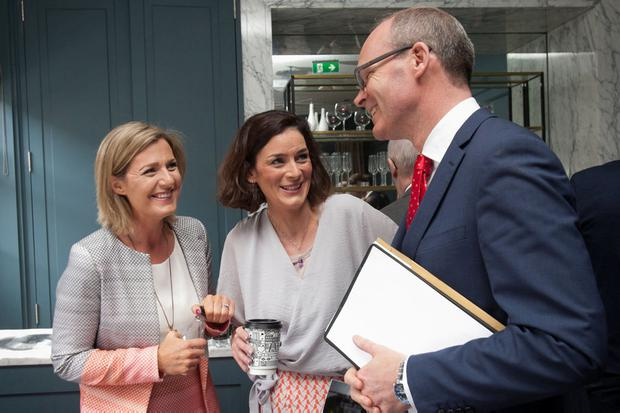 Talking politics: Fine Gael TDs Maria Bailey (left) and Kate O'Connell with Tánaiste Simon Coveney at the Dean Hotel, Dublin in 2017. Photo: Gareth Chaney, Collins