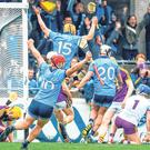 Dublin's players jump for joy after Sean Moran's late goal earns them a draw with Wexford. Photo: Sportsfile