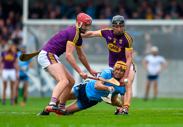 Eamon Dillon of Dublin battles against Paudie Foley, left, and Liam Óg McGovern of Wexford. Photo: Sportsfile