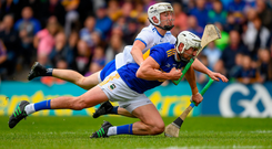 Conor Gleeson hauls down Tipperary's 'Bonner' Maher, resulting in the Waterford man being sent off. Photo: Sportsfile