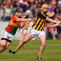 Seamus Murphy of Carlow tries to hook Kilkenny's Richie Leahy. Photo: Sportsfile