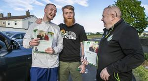 Fighting his corner: Sinn Féin candidate in Tallaght South, Dublin, Paddy Holohan (centre) chats with Liverpool player Glen McAuley. Photo: Kyran O'Brien