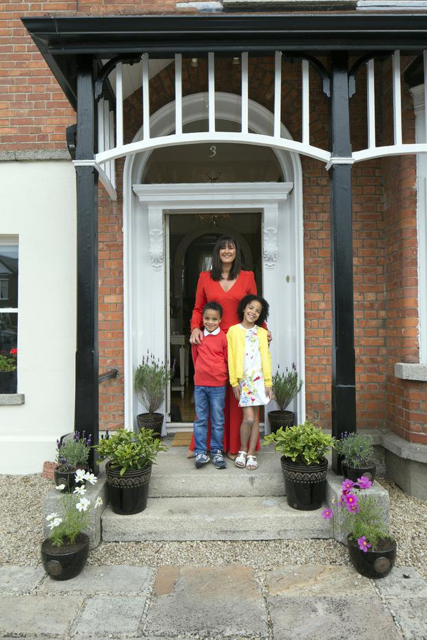 Rhoda outside her period home in Dublin 4 with Juliet and Samuel. She originally bought the house with her sister Sinead who has a business, housedr.ie. Padraig Pearse lived here from the age of seven to 11. Photo: Tony Gavin