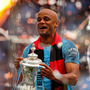 Vincent Kompany parades the FA Cup around Wembley after his final game for Manchester City. Photo: Richard Heathcote/Getty Images