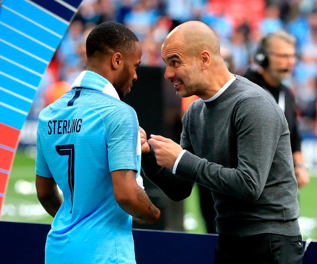 Pep Guardiola still finds time for coaching notes after the final Photo: Mike Egerton/PA Wire