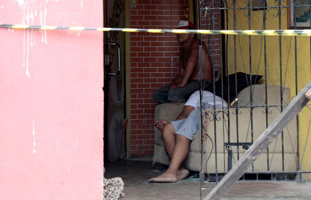 A man is seen next to a body where, according to local media, an armed group had entered and opened fire in a bar, killing and wounding its patrons, in Para state, Brazil REUTERS/Mauro Angelo