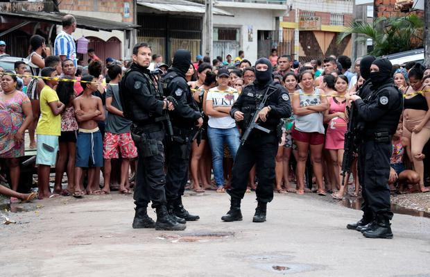 Policemen are seen at a site where, according to local media, an armed group entered and opened fire at a bar, killing and wounding its patrons, in Belem, Para state, Brazil REUTERS/Mauro Angelo
