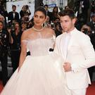 Actress Priyanka Chopra, left, and singer Nick Jonas pose for photographers upon arrival at the premiere of the film 'The Best Years of a Life' at the 72nd international film festival, Cannes, southern France, Saturday, May 18, 2019. (Photo by Arthur Mola/Invision/AP)