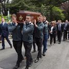 Members of the current Dublin Senior football team carry legend Anton O'Toole remains to the the Church of St Paul of the Cross, Mount Argus in Dublin. Pic:Mark Condren 20.5.2019