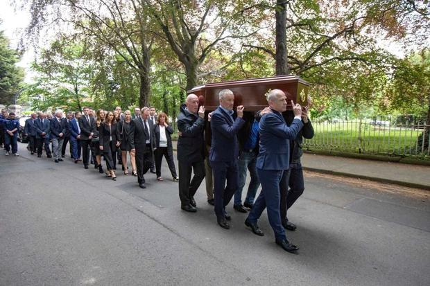 Mourners at the funeral of Dublin legend Anton O'Toole. Pic: Mark Condren