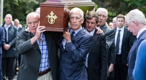 Bobby Doyle, Kevin Moran and Paddy Cullen shoulder the remains of Anton O'Toole for his funeral mass in the Church of St Paul of the Cross, Mount Argus, Dublin. Pic:Mark Condren 20.5.2019
