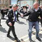 Direct hit: Brexit Party leader Nigel walks away after a protester struck him with a milkshake during a campaign walkabout in Newcastle. Photo: Reuters/Scott Heppell