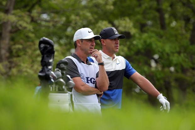 Brooks Koepka and caddie Ricky Elliott during the final round of the PGA Championship golf tournament. Photo: Peter Casey-USA TODAY Sports