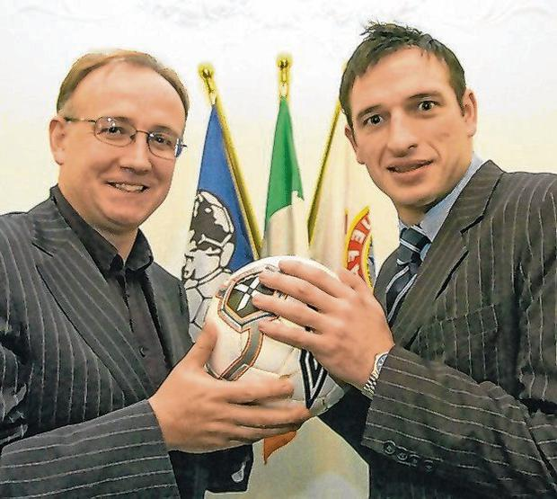 Noel Mooney with the FAI's Fran Gavin after being appointed National Clubs Promotion Officer in 2006. Photo: Brendan Moran / Sportsfile