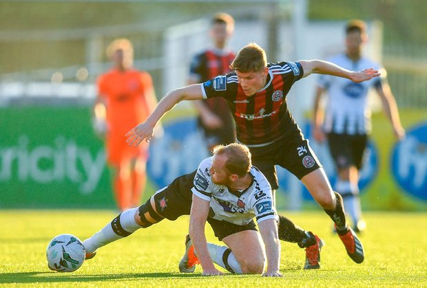 Chris Shields of Dundalk in action against Ryan Swan of Bohemians. Photo by Ramsey Cardy/Sportsfile