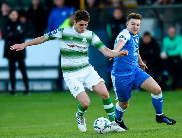 Dylan Watts of Shamrock Rovers in action against Tony McNamee of Finn Harps. Photo by Oliver McVeigh/Sportsfile