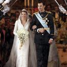 Spanish Crown Prince Felipe de Bourbon and his bride, Princess Letizia Ortiz pose for a picture after their wedding ceremony at the Almudena cathedral May 22, 2004 in Madrid. (Photo by Pascal Le Segretain/Getty Images)