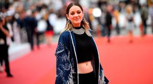 French actress Marion Cotillard poses as she arrives for the screening of the film