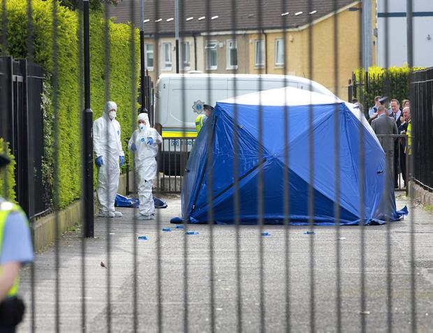 Garda forensics pictured in the laneway beside Our Lady of Immaculate National School in Darndale where a man was fatally shot.Pivture Credit:Frank McGrath 22/5/19
