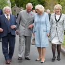 Close ties: President Michael D Higgins (left) and his wife Sabina (right) with Britain's Prince Charles and his wife Camilla on a visit to Glencree, Co Wicklow, on Monday. Photo: Julien Behal