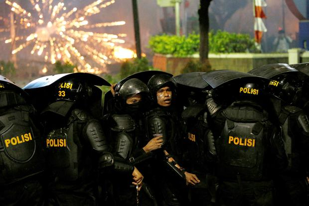 Public anger: Police in clashes with protesters in Jakarta yesterday. Photo: Ulet Ifansasti/Getty