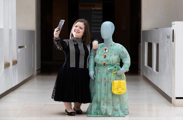Model: Sinéad Burke in a dress by Christopher Kane and stands by a design fitted to a mannequin cast from her body. Photo: PA