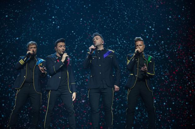 The boys are back: Westlife's Kian Egan, Shane Filan, Nicky Byrne and Mark Feehily performing at the SSE Arena, Belfast, last night. Picture: Mark Condren