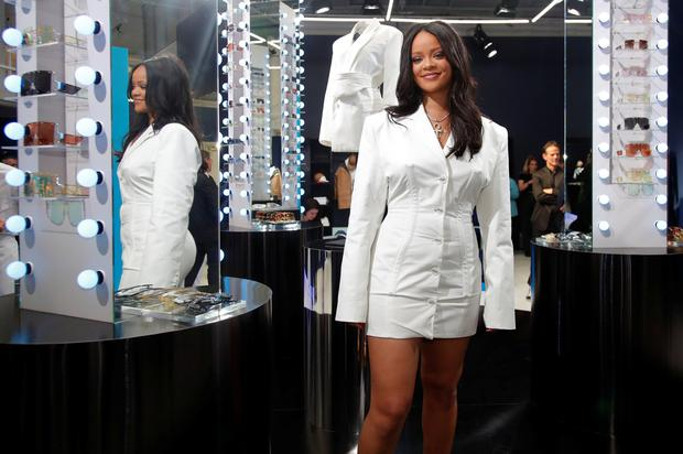 Pop superstar Rihanna poses in a pop-up store to present her first collection with LVMH for the new label, Fenty, which includes ready-to-wear and accessories, such as shoes, sunglasses and jewellery, Paris, France May 22, 2019. Picture taken May 22, 2019. REUTERS/Charles Platiau