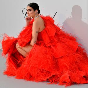 British singer-songwriter Dua Lipa poses as she arrives on May 23, 2019 for the amfAR 26th Annual Cinema Against AIDS gala at the Hotel du Cap-Eden-Roc in Cap d'Antibes, southern France, on the sidelines of the 72nd Cannes Film Festival. (Photo by Alberto PIZZOLI / AFP)