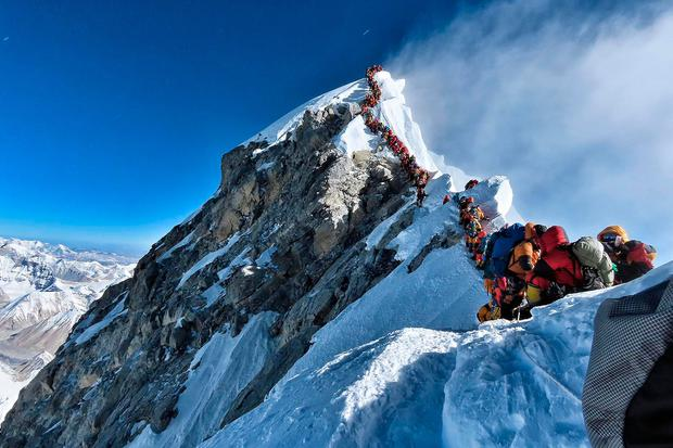 This photo shows heavy traffic of mountain climbers lining up to stand at the summit of Mount Everest. Photo: AFP PHOTO / PROJECT POSSIBLE