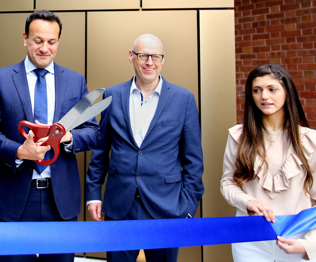 Cutting it: Taoiseach Leo Varadkar with Dean of Business Andrew Burke and student Dina Abu-Rahmeh at the official opening of Trinity Business School. Photo: Gerry Mooney