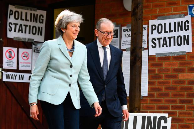 End game: Prime Minister Theresa May and her husband Philip leave a polling station after casting their votes in her Maidenhead constituency. Photo: Victoria Jones/PA
