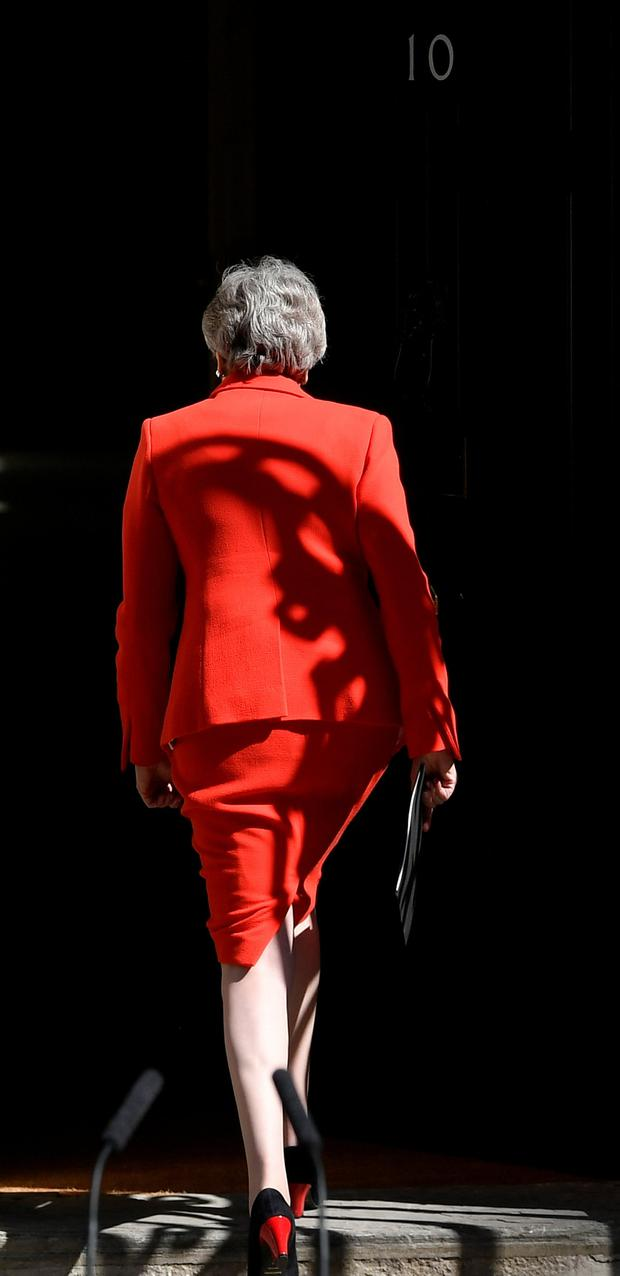 British Prime Minister Theresa May leaves after delivering a statement in London, Britain, May 24, 2019. REUTERS/Toby Melville