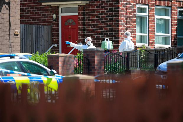 Forensics officers at a property on Gregg House Road in Shiregreen, Sheffield, after six children were taken to hospital following a
