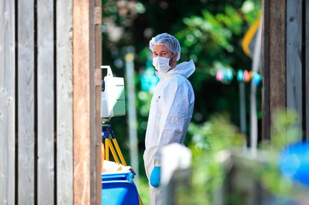 A forensics officer at a property on Gregg House Road in Shiregreen, Sheffield, after six children were taken to hospital following a