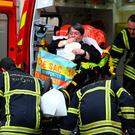 Explosion: Emergency service workers help a woman into an ambulance after the suspected bomb blast in Lyon. Photo: PHILIPPE DESMAZES/AFP/Getty Images