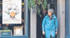 A style of her own: UK Prime Minister Theresa May leaves the Smith England hairdresser salon during a visit to Salisbury. Photo: FACUNDO ARRIZABALAGA/BLOOMBERG
