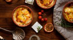 It's not that difficult to make, writes Katy McGuinness, but if you simply don't have the time and are in the mood to indulge, which brand of potato gratin is the closest thing to home-made?