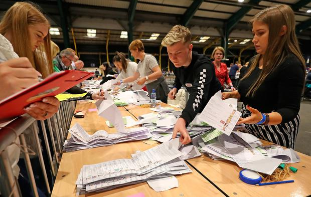 The ballot boxes are opened at the RDS in Dublin on Saturday morning. Photo: Niall Carson/PA Wire